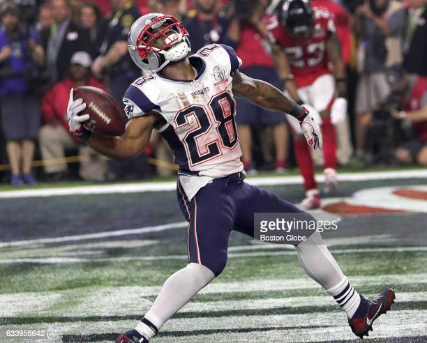 New England Patriots running back James White spikes the football after scoring a touchdown during the fourth quarter. The Atlanta Falcons play the...