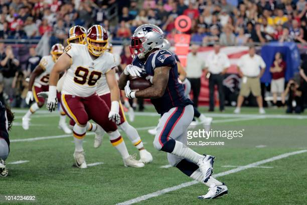 New England Patriots running back Jeremy Hill carries the ball during a preseason NFL game between the New England Patriots and the Washington...