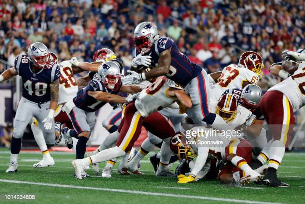 New England Patriots running back Jeremy Hill dives for the end zone during a preseason NFL game between the New England Patriots and the Washington...