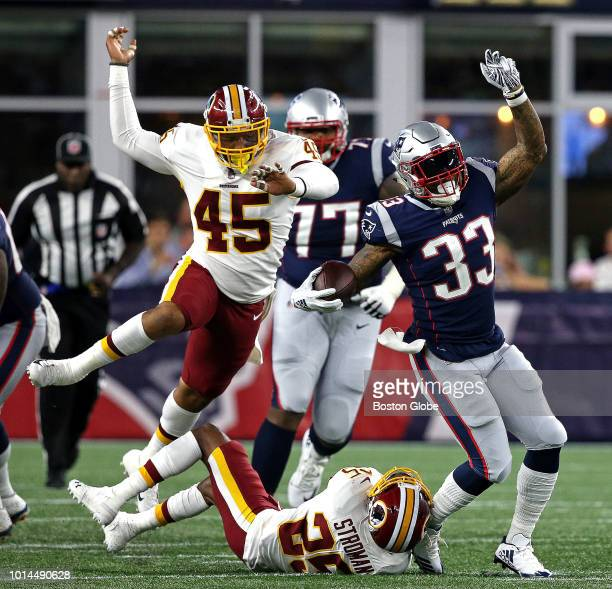 New England Patriots running back Jeremy Hill runs for a first down during the first quarter The New England Patriots host the Washington Redskins in...