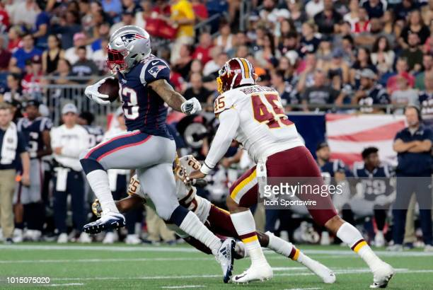 New England Patriots running back Jeremy Hill tries to split Washington Redskins defensive back Greg Stroman and Washington Redskins linebacker Pete...