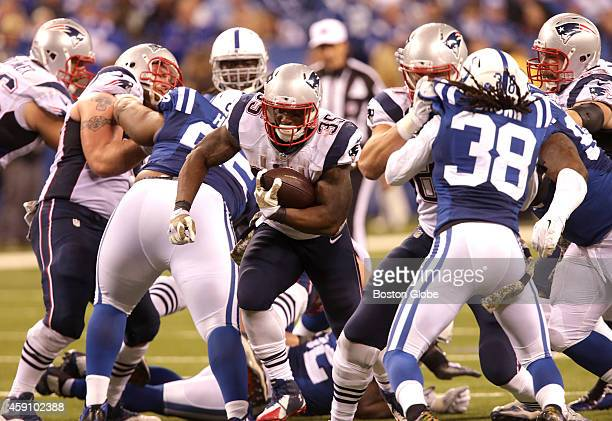 New England Patriots running back Jonas Gray breaks through a gap in the defense for a fourth quarter first down The New England Patriots took on the...