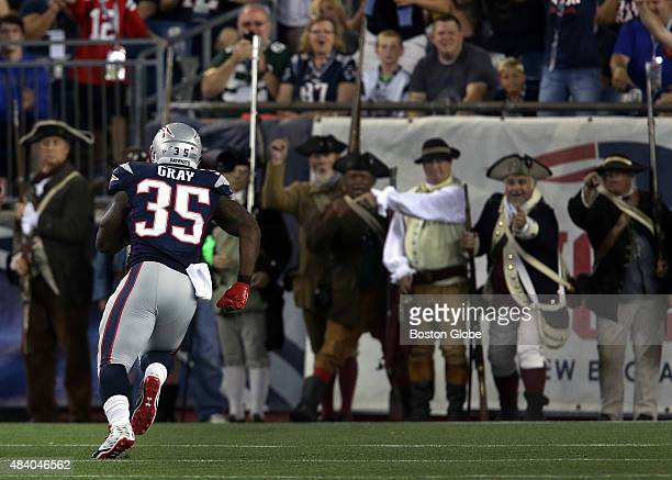 New England Patriots running back Jonas Gray had a welcoming receiving line of End zone Militia as he ran untouched for a successful two point...