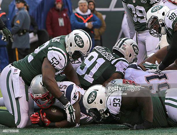 New England Patriots running back Jonas Gray plunges into the end zone for a New England touchdown early in the fourth quarter New York Jets head...