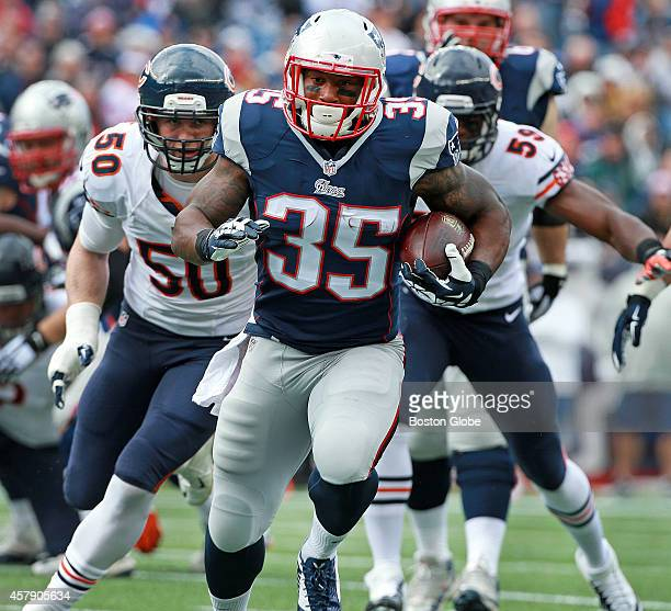 New England Patriots running back Jonas Gray rumbles for a first quarter first down The New England Patriots hosted the Chicago Bears in a regular...