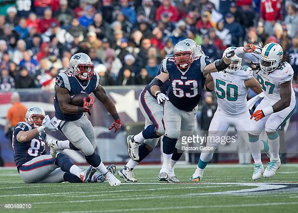 New England Patriots running back Jonas Gray runs for a 14yard gain as teammate Dan Connolly points the way and blocks the Miami Dolphins' Kelvin...