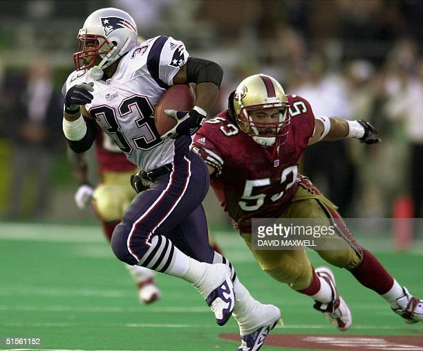 New England Patriots running back Kevin Faulk eludes the tackle attempt of San Francisco 49er's linebacker Jeff Ulbrich during the second quarter of...
