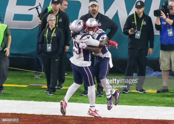New England Patriots running back LeGarrette Blount hugs New England Patriots running back James White for scoring the winning touchdown in overtime...
