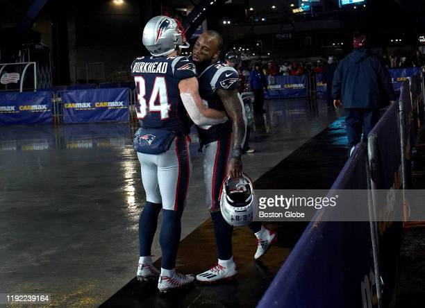 New England Patriots running back Rex Burkhead and New England Patriots running back James White embrace as they leave the field following the end of...