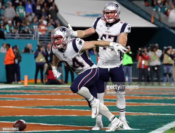 New England Patriots running back Rex Burkhead and tight end Jacob Hollister celebrate Bulkhead's touchdown during the second quarter of a game...