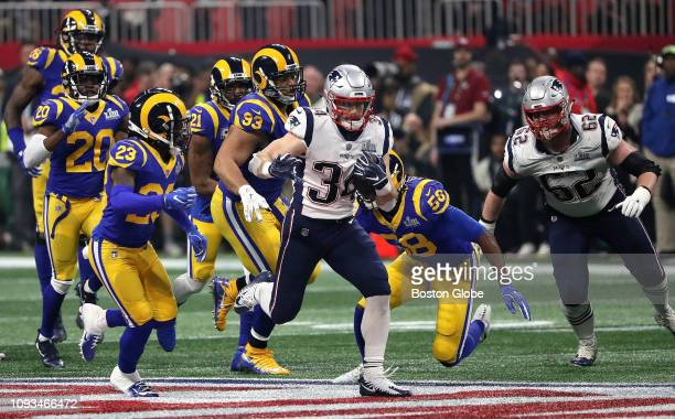 New England Patriots running back Rex Burkhead breaks loose for a long first down run after a key interception by New England Patriots cornerback...