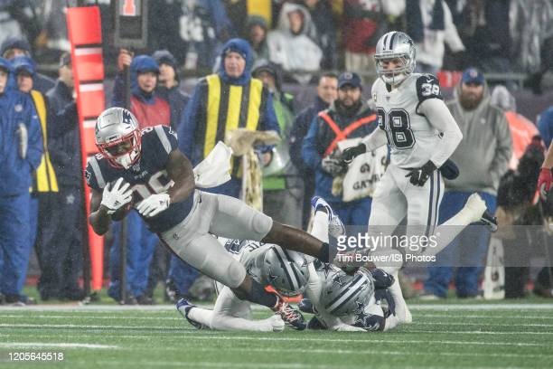 New England Patriots Running Back Sony Michel is tackled by Dallas Cowboys Cornerback Chidobe Awuzie and Dallas Cowboys Safety Xavier Woods during a...