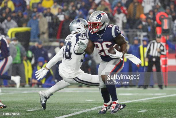 New England Patriots running back Sony Michel slips past Dallas Cowboys defensive end Robert Quinn during a game between the New England Patriots and...