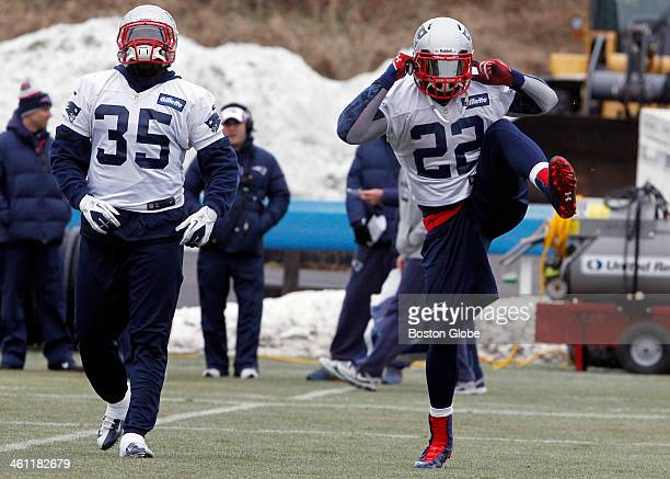 New England Patriots running back Stevan Ridley right stretches beside practice squad running back Cierre Wood during practice on the practice field...
