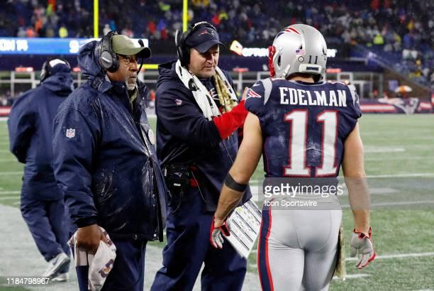 New England Patriots running backs Coach Ivan Fearsa nd New England Patriots special teams coordinator / wide receivers coach Joe Judge talk with New...