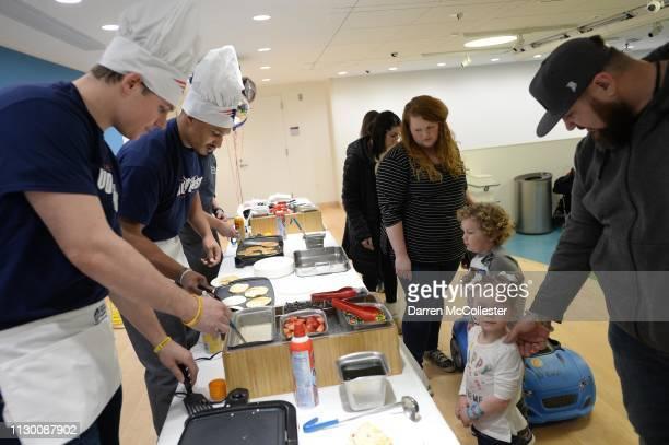 New England Patriot's Ryan Izzo and Derek Rivers flip pancakes for the kids at Boston Children's Hospital March 12, 2019 in Boston, Massachusetts.
