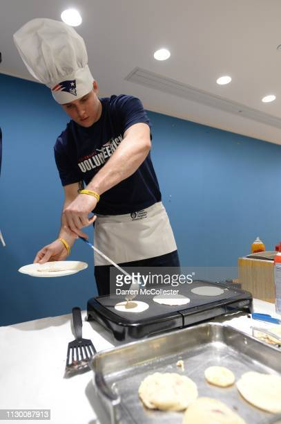 New England Patriot's Ryan Izzo flips pancakes for the kids at Boston Children's Hospital March 12 2019 in Boston Massachusetts