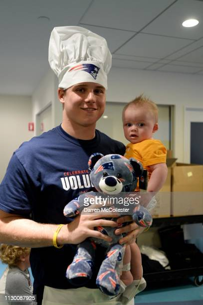 New England Patriot's Ryan Izzo takes a picture with Hezekiah at Boston Children's Hospital March 12, 2019 in Boston, Massachusetts.