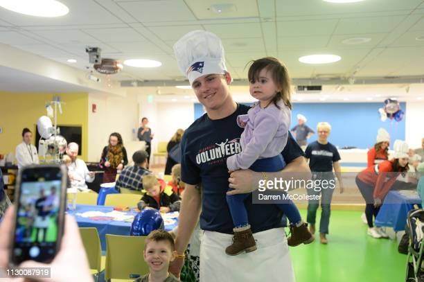 New England Patriot's Ryan Izzo takes a picture with Logan and Lacie at Boston Children's Hospital March 12 2019 in Boston Massachusetts