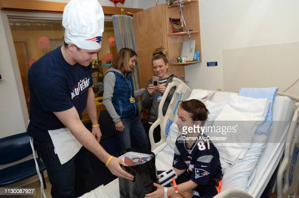 New England Patriot's Ryan Izzo visits with Liam at Boston Children's Hospital March 12, 2019 in Boston, Massachusetts.