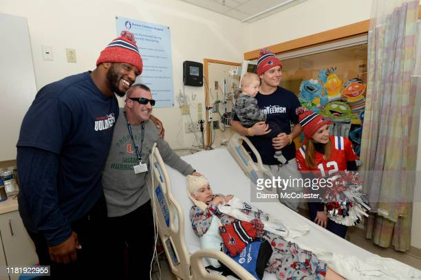 New England Patriots Shilique Calhoun, Ryan Izzo, and cheerleader Alexis Melvin visit with Michael and family at Boston Children's Hospital November...