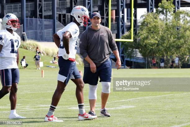 New England Patriots special teams coordinator / wide receivers coach Joe Judge talks with New England Patriots wide receiver Dontrelle Inman during...