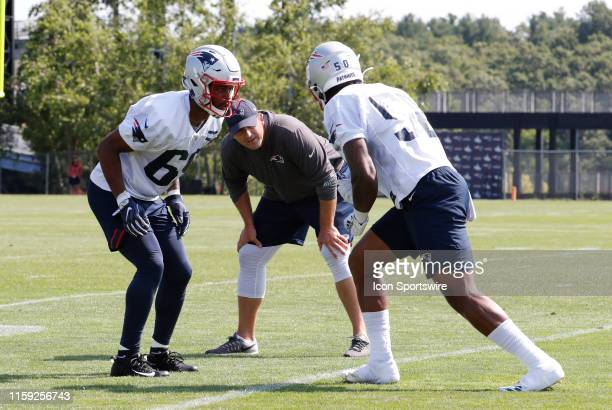 New England Patriots special teams coordinator / wide receivers coach Joe Judge checks the positioning of New England Patriots wide receiver NKeal...
