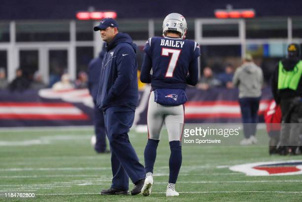 New England Patriots special teams coordinator / wide receivers coach Joe Judge and New England Patriots punter Jake Bailey during warm up before a...