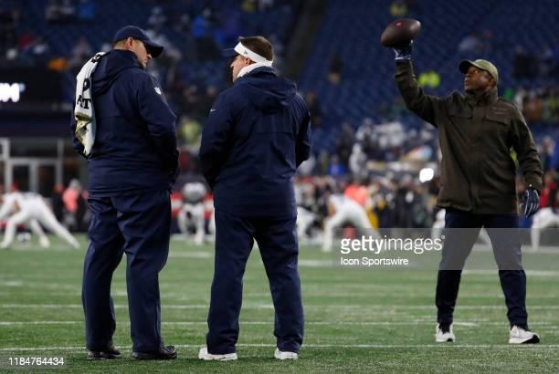 New England Patriots special teams coordinator / wide receivers coach Joe Judge talks with New England Patriots offensive coordinator / quarterbacks...