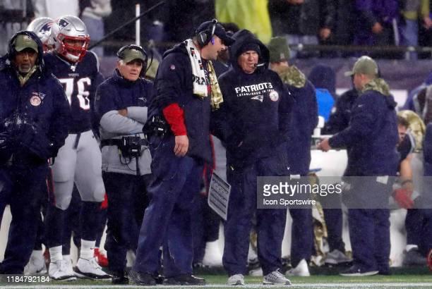 New England Patriots special teams coordinator / wide receivers coach Joe Judge speaks with New England Patriots head coach Bill Belichick during a...