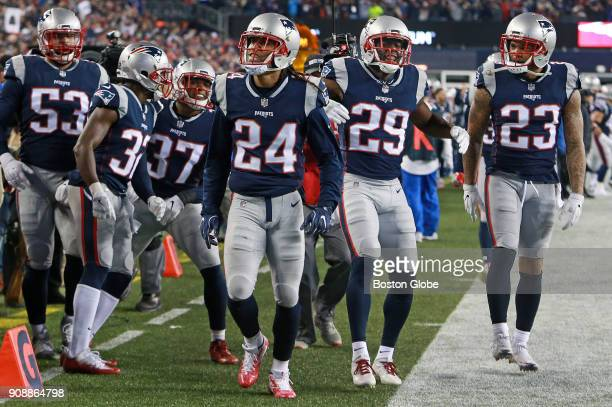 New England Patriots' Stephon Gilmore and fellow defenders Devin McCourty Jordan Richards Johnson Bademosi and Patrick Chung celebrate after Gilmore...