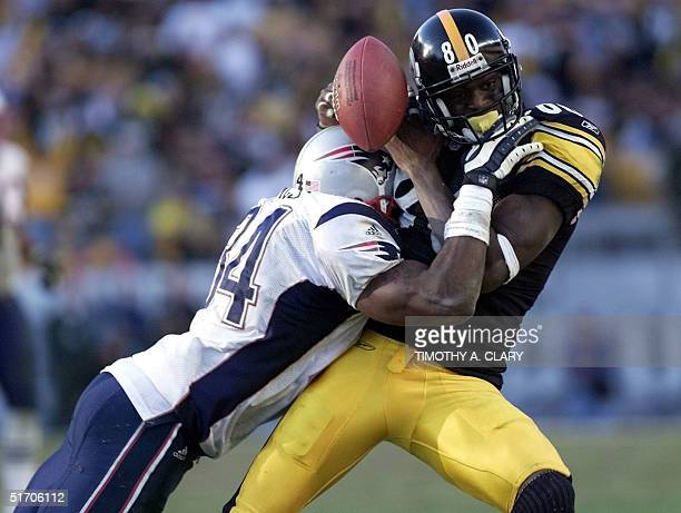 New England Patriots Tebucky Jones hits Pittsburgh Steelers wide receiver Plaxico Burress knocking the ball out of his hands for an incomplete pass...