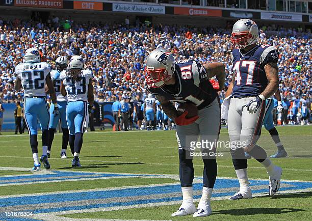 New England Patriots tight end Aaron Hernandez takes a bow after his pass reception and run for a touchdown in the first quarter of the New England...
