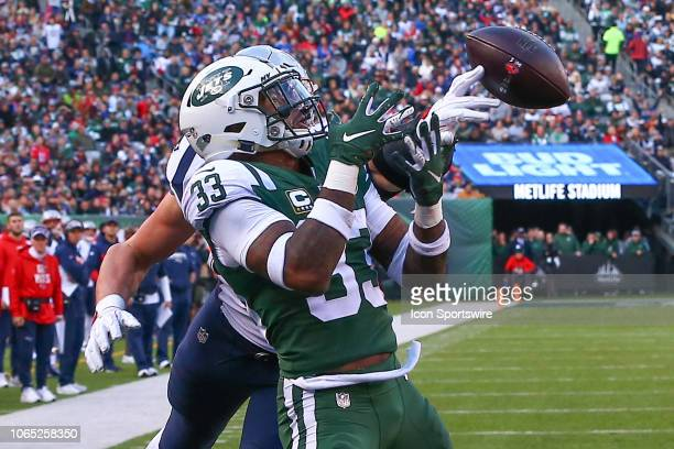 New England Patriots tight end Rob Gronkowski breaks up an interception attempt by New York Jets strong safety Jamal Adams during the third quarter...