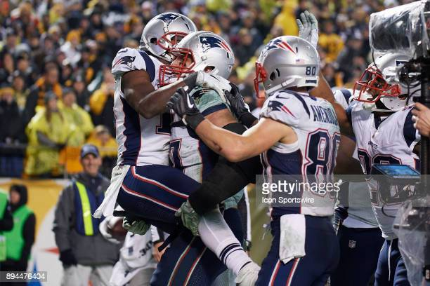 New England Patriots tight end Rob Gronkowski celebrates with team mates after catching the ball for the 2 point conversion in the fourth quarter...