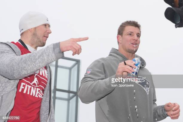 New England Patriots tight end Rob Gronkowski chugs a beer during the Victory Parade through the streets of Boston on February 7 in Boston...