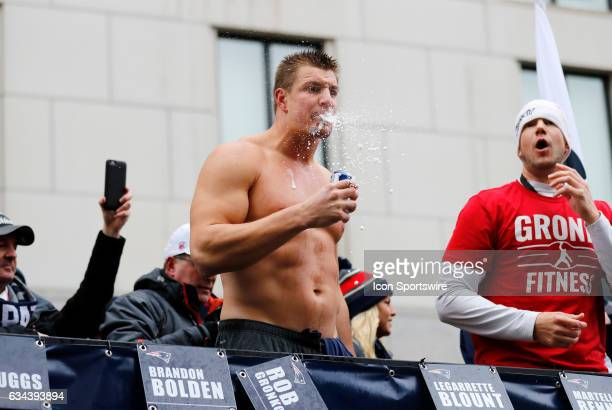 New England Patriots tight end Rob Gronkowski drinks a beer during the Patriots Victory Parade through the streets of Boston on February 7 in Boston...