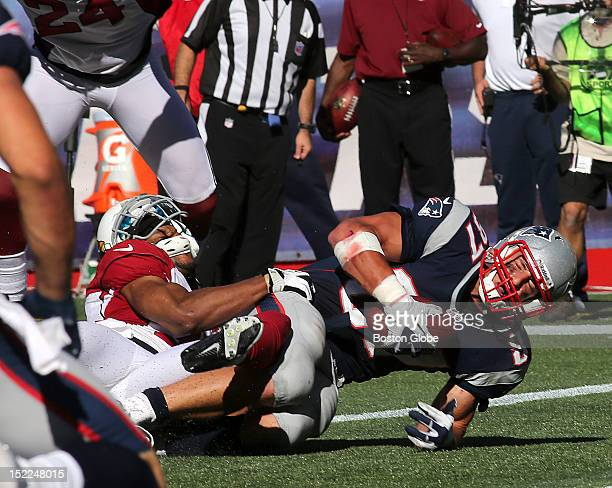 New England Patriots tight end Rob Gronkowski lands in the end zone to score a touchdown late in the fourth quarter, which brought the Patriots...