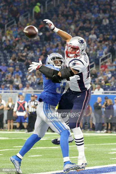 New England Patriots tight end Rob Gronkowski reaches for a pass under pressure from Detroit Lions strong safety Tavon Wilson during the first half...