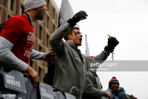 New England Patriots tight end Rob Gronkowski with a beer and shot during the Patriots Victory Parade through the streets of Boston on February 7 in...