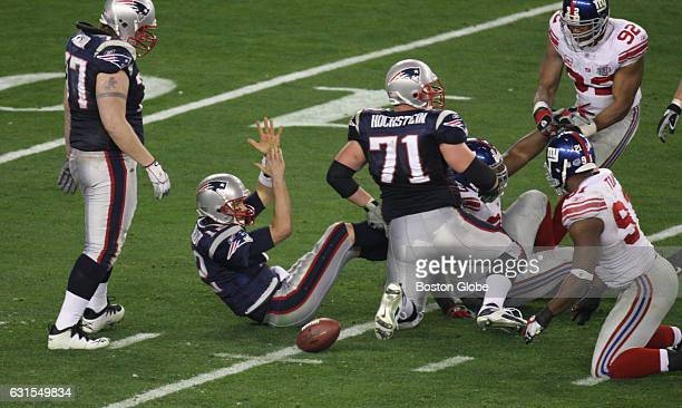 New England Patriots' Tom Brady calls a time out after getting sacked at the end of the fourth quarter. New England Patriots face the New York Giants...