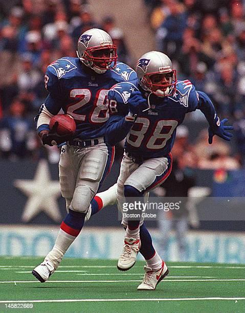 New England Patriots versus the Dallas Cowboys Curtis Martin runs behind Terry Glenn