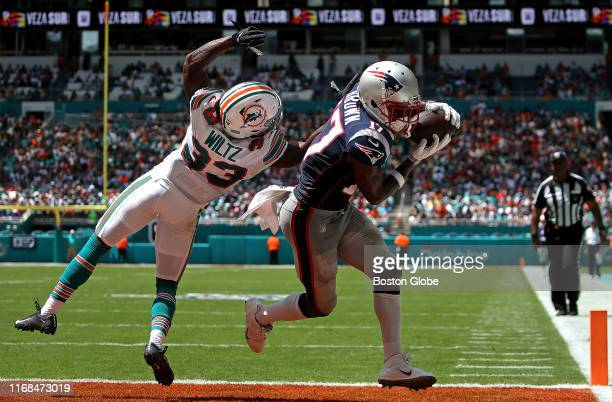 New England Patriots wide receiver Antonio Brown makes the reception over Miami Dolphins cornerback Jomal Wiltz for his first touchdown as a Patriot...
