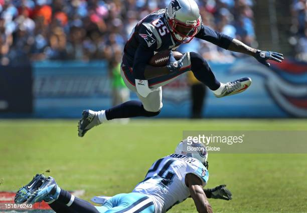 New England Patriots wide receiver Brandon Lloyd hurdles Tennessee Titans cornerback Coty Sensabaugh for a six-yard gain on a third quarter drive...