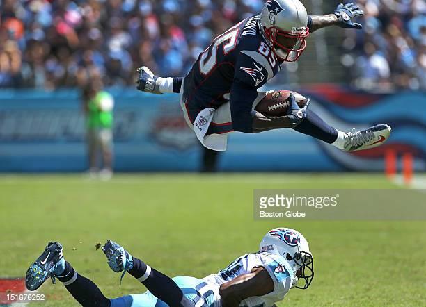 New England Patriots wide receiver Brandon Lloyd hurdles Tennessee Titans cornerback Coty Sensabaugh for a sixyard gain on a third quarter drive that...