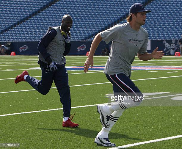 New England Patriots wide receiver Chad Ochocinco and New England Patriots quarterback Tom Brady were out on the field early as the New England...