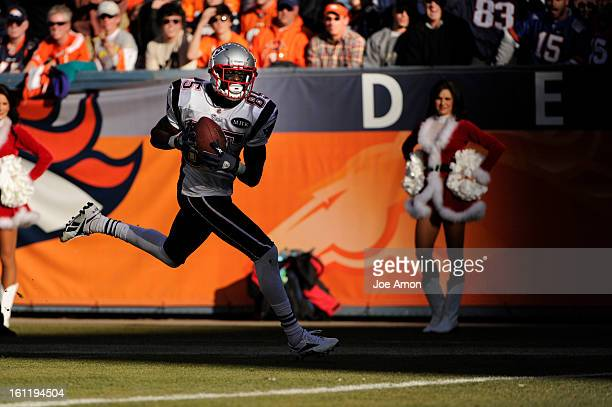 New England Patriots wide receiver Chad Ochocinco pulls in a touchdown catch in the first half at Sports Authority Field at Mile High Denver Sunday...