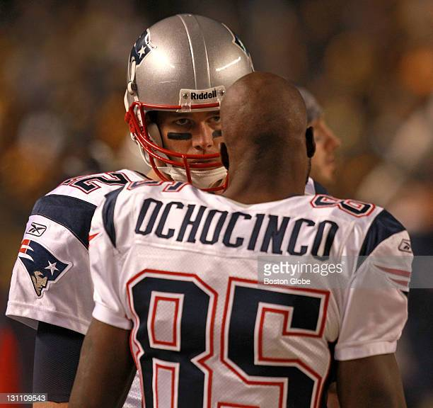 New England Patriots wide receiver Chad Ochocinco tried to talk to New England Patriots quarterback Tom Brady after a blown play during the fourth...