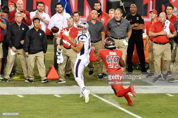 New England Patriots wide receiver Chris Hogan catches a pass while defended by Tampa Bay Buccaneers linebacker Devante Bond during an NFL football...