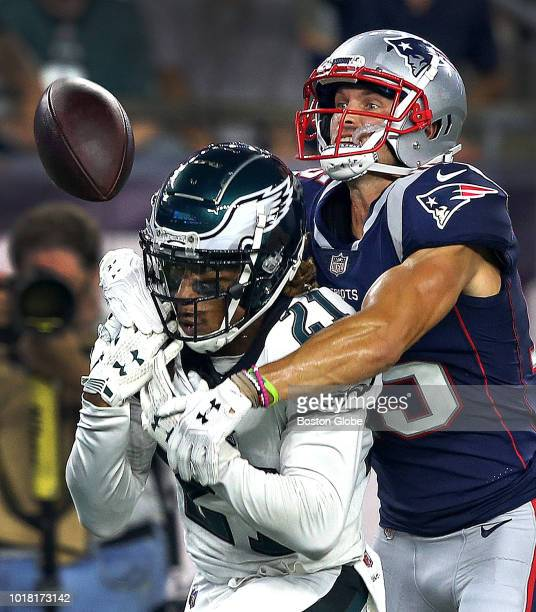 New England Patriots wide receiver Chris Hogan has to play defense and break up this potential interception by Philadelphia Eagles cornerback Ronald...